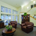 Common living room area with comfortable brown chairs and a table