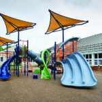 view of outdoor playground with slides and plane-like canopies